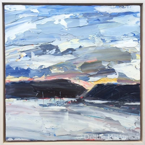 LAST RAYS by Debbie Mackinnon is an image of an oil painting at sunset of a mostly blue seascape painting with distant boats and dark rocks depicting a storm possibly coming