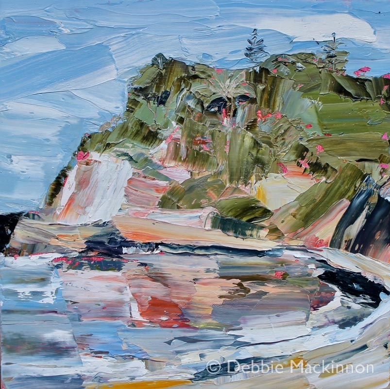 GOLDEN GLOW is an image of an abstract colourful oil painting with large green landscapes, blue sky and ocean with colourful rocks by Sydney artist Debbie Mackinnon