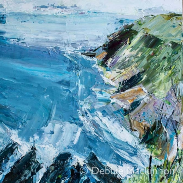 BEYOND THE BREAKERS is an oil painting by Debbie Mackinnon, Sydney artist featuring deep blue sea with yellow and pink rocks and trees and grass, with waves crashing